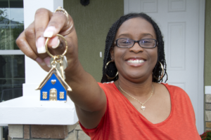 A Habitat homeowner with a key