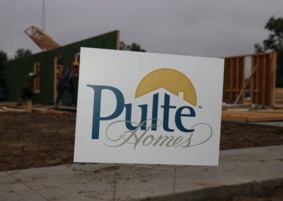 Pulte Homes sign in front of walls being raised