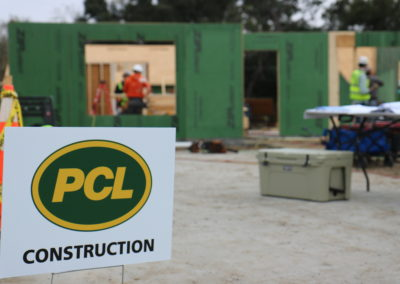 PCL Construction sign in front of in-progress house