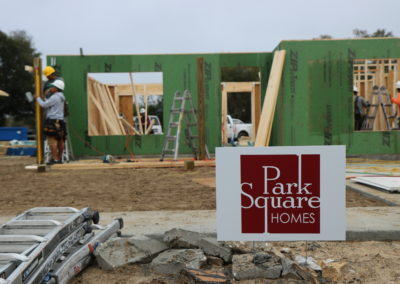 Park Square Homes sign in front of in-progress house