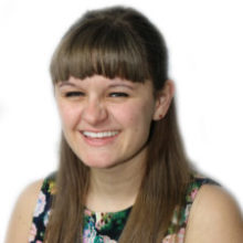 Staff member Amanda smiling on a white background