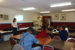 A Fleet Farming representative speaks to Greater Malibu Groves residents at a local church.