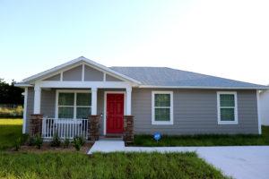 Sample Juniper Bend home exterior with red door
