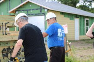 Crew leader Bill explains a task to a volunteer at a Habitat Orlando & Osceola build site.