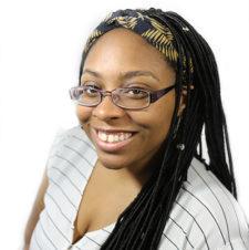 Staff member Karina smiling on a white background