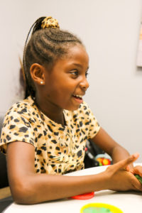 Juliet's daughter playing with Play-Doh at headquarters
