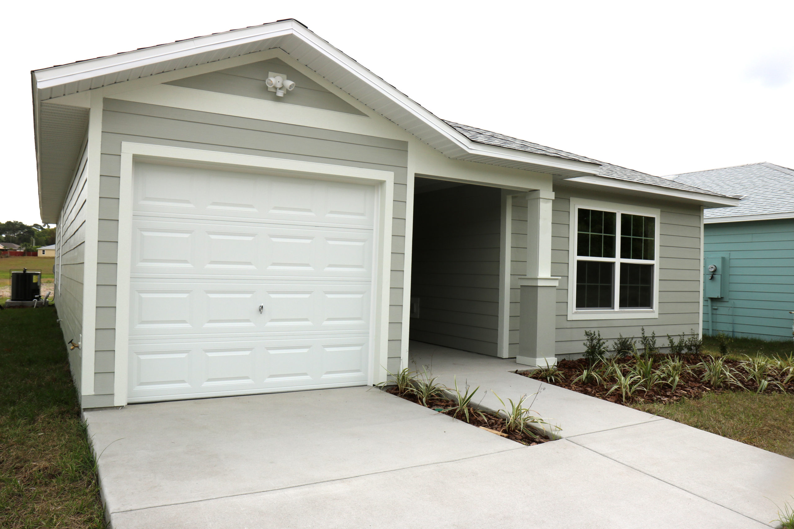 The front of a gray home in the Habitat Orlando community of Silver Pines Pointe.
