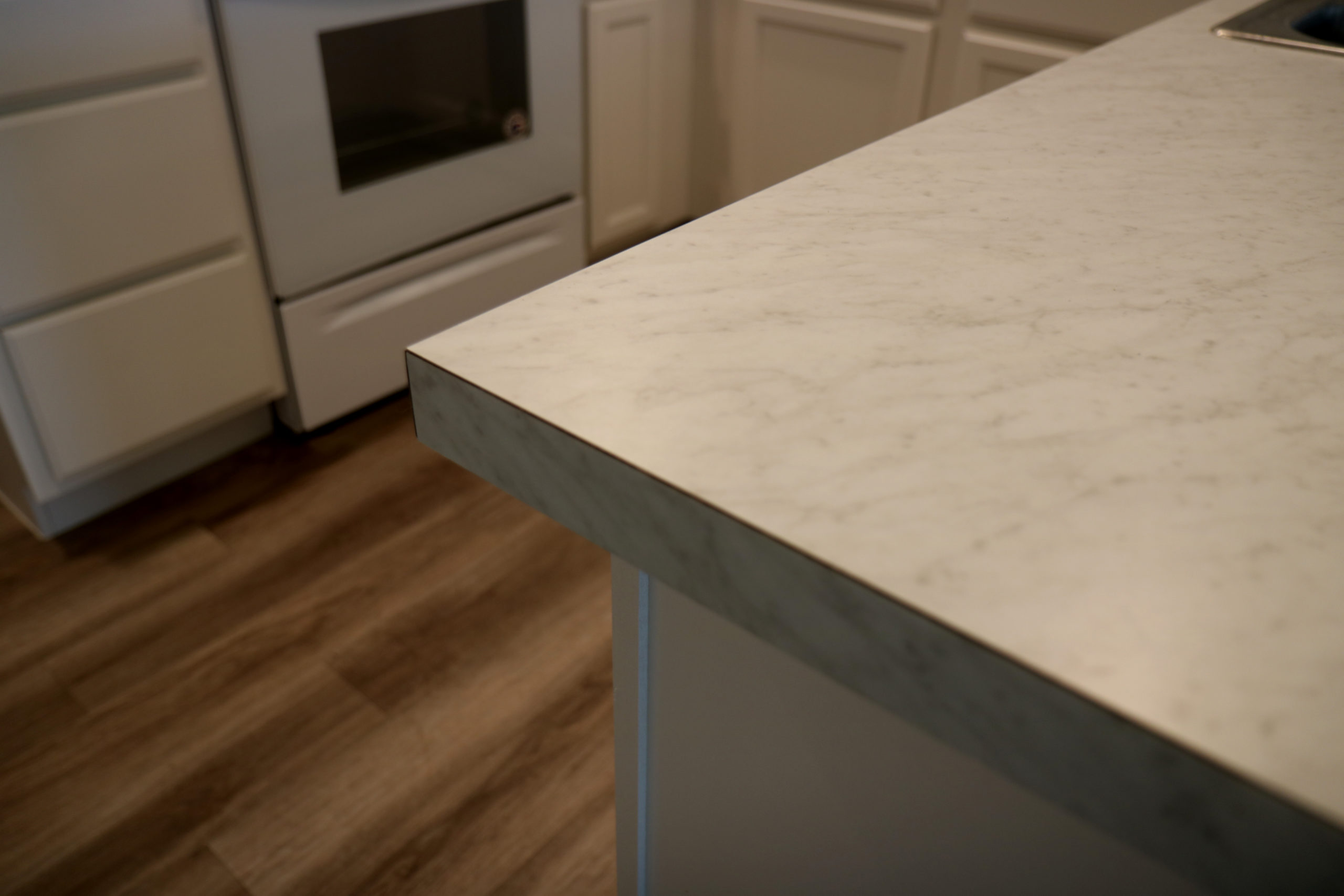 A close-up of white cabinetry and countertops in the Habitat Orlando community of Silver Pines Pointe.