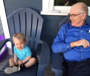 Habitat board chair Pete Barr, Jr., right, sits with his grandson