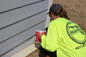 A PaverScape volunteer works at a Habitat Orlando & Osceola build site.