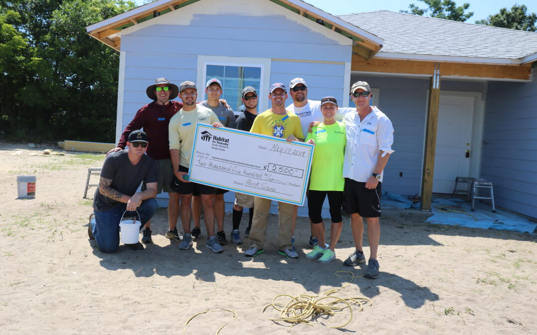 PaverScape Inc. volunteers pose for a photo at a Habitat Orlando & Osceola build site.