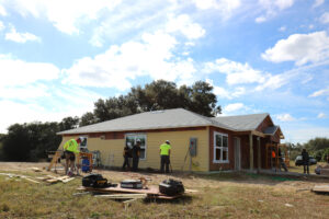 Construction workers work on a Habitat home