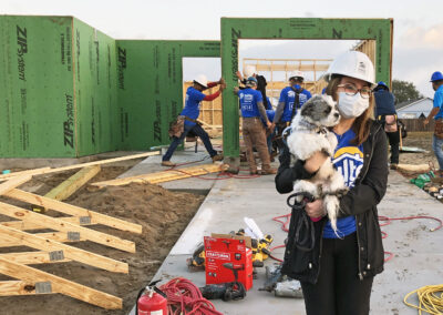 Woman with dog in front of active construction site