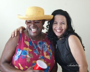 Two women smile at the camera